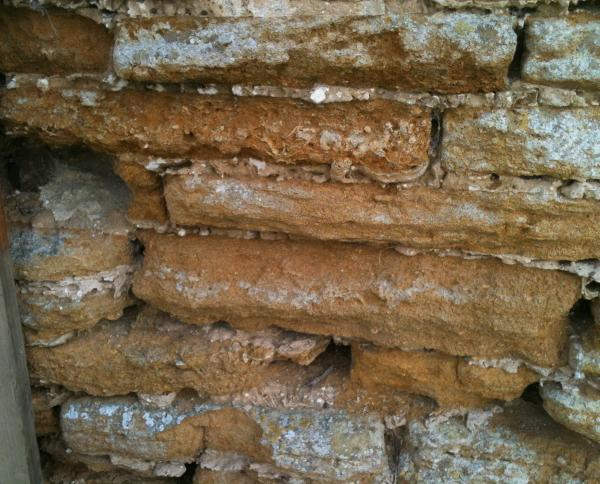 Original sandstone building blocks in the perimeter wall,